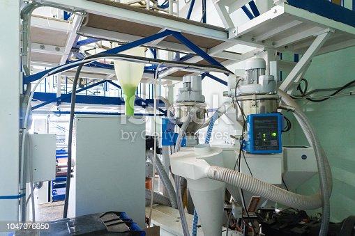 istock Blown film extrusion plastic bag making machine 1047076650