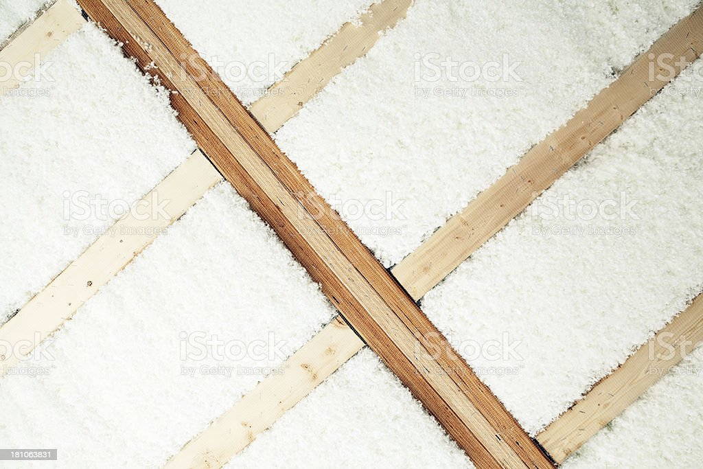 Blown Insulation Installed Between House Floor Joists stock photo