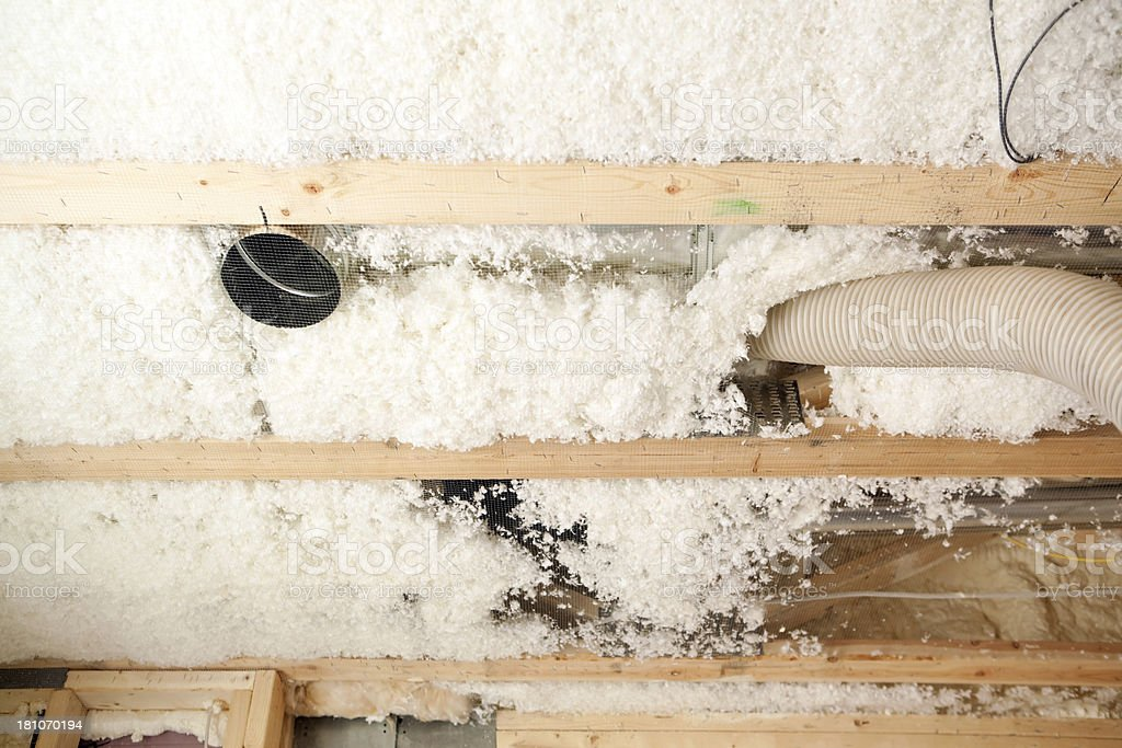 Blown Insulation Installing Between House Floor Joists stock photo