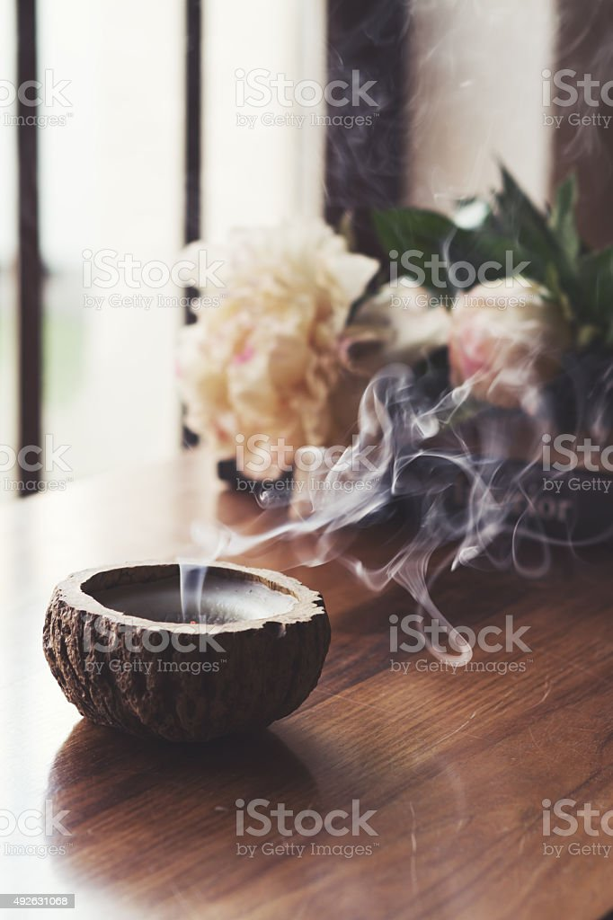 Blown out candle smoke, in home interior setting stock photo