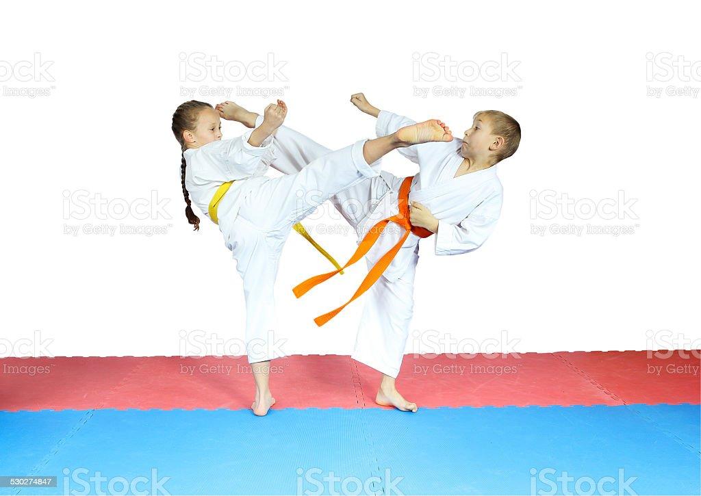Blows kicks are doing little athletes in karategi stock photo