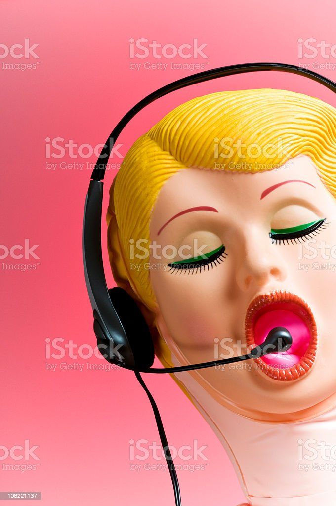 Blow-up Doll Wearing Telephone Headset stock photo