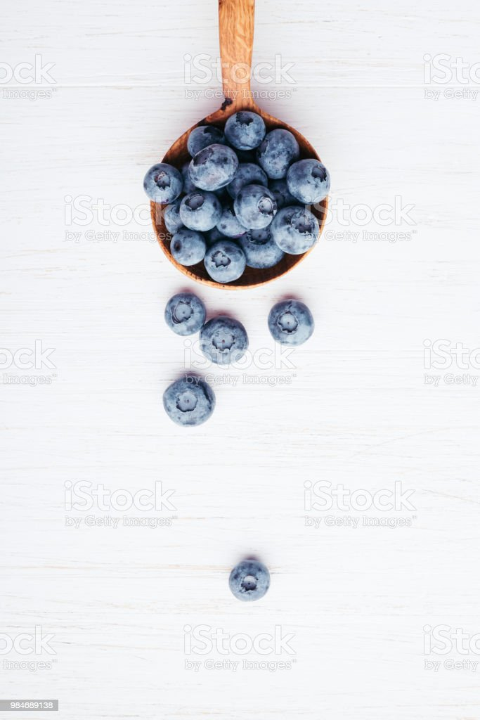 Bluberries in wooden spoon. stock photo
