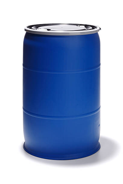 Blue 55 Gallon Barrel on White 55 Gallon blue barrel was shot in studio.  This was a new barrel that I was shooting in studio for a client.  I decided to do a few stock shots for your own personal needs.  Shot on a Canon 5D. gallon stock pictures, royalty-free photos & images