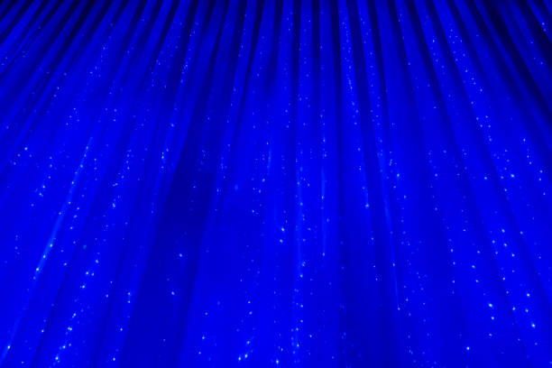 Blue abstract background. Curtain with glowing lights