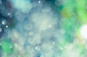 Shiny sparkles of on a blue background with a hint of green. Resembles bubbles underwater. Great background for a winter holiday project.