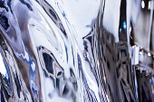 Blue shiny metal reflection, background with copy space, full frame horizontal composition