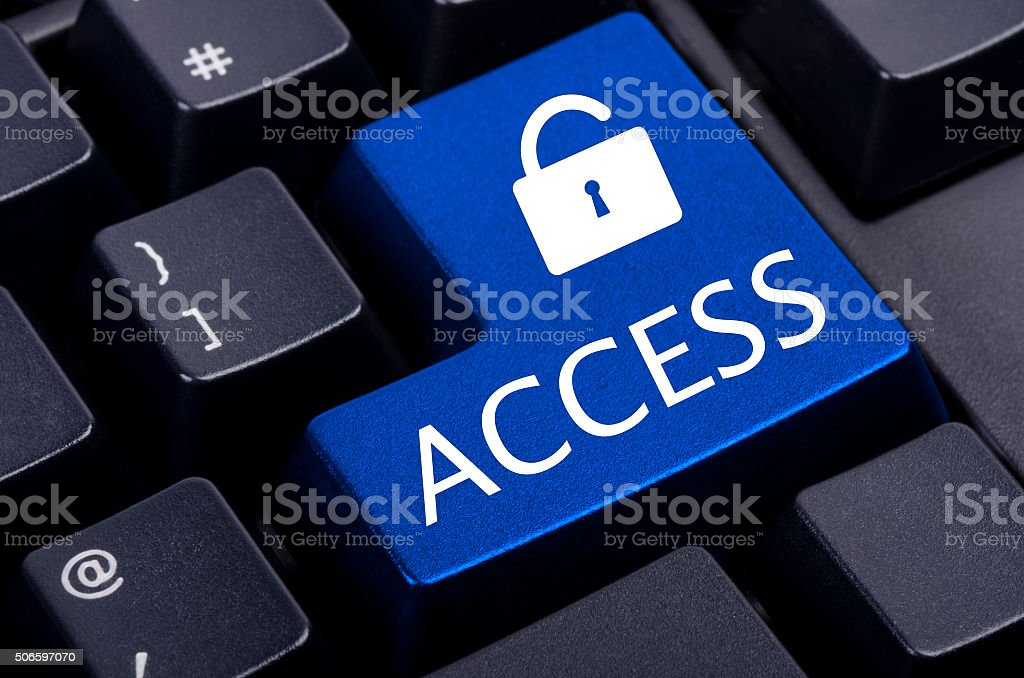 blue access button on a black computer stock photo