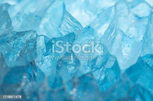Macro photo of a pale blue, polished, agate stone.