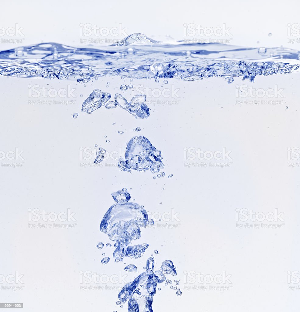Blue air bubbles floating under water surface royalty-free stock photo