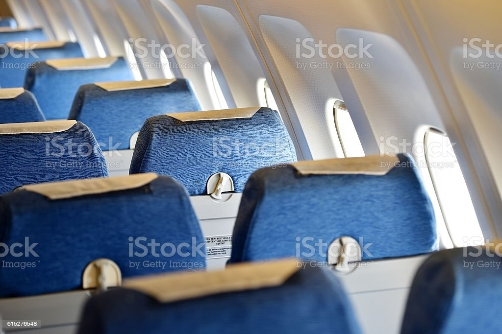 Blue airplane empty seats stock photo