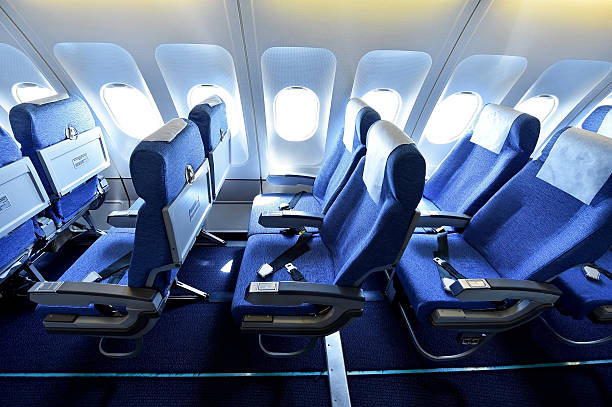 blue airplane empty seats - airplane seat 뉴스 사진 이미지