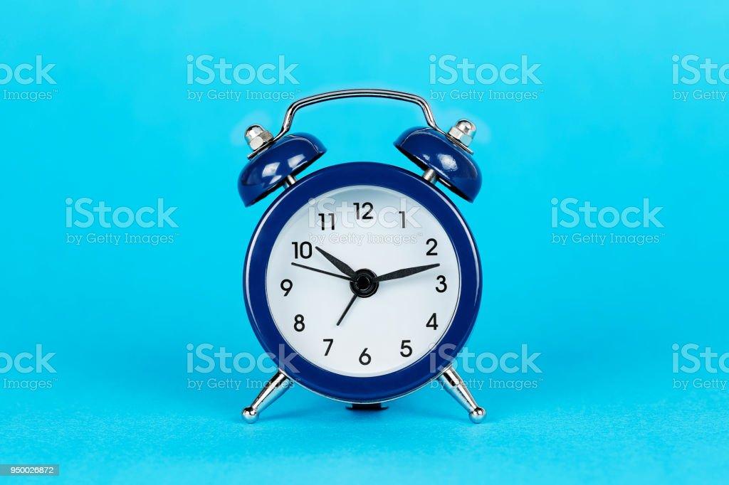 blue alarm clock stock photo