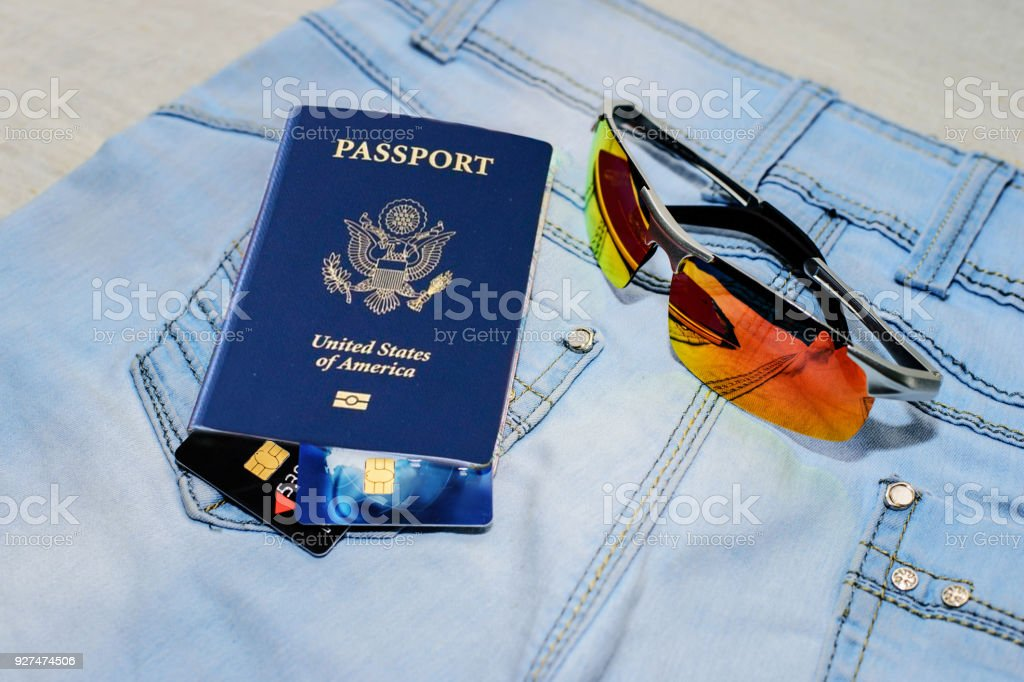 Blue American Passport, money and home - the concept of buying a property. stock photo