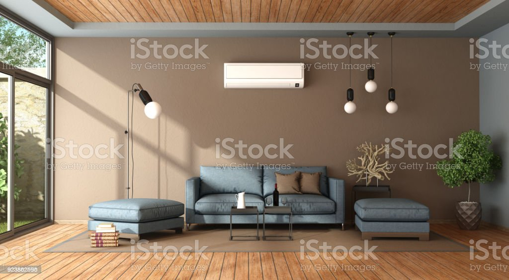 Blue and brown living room with air conditioner - foto stock