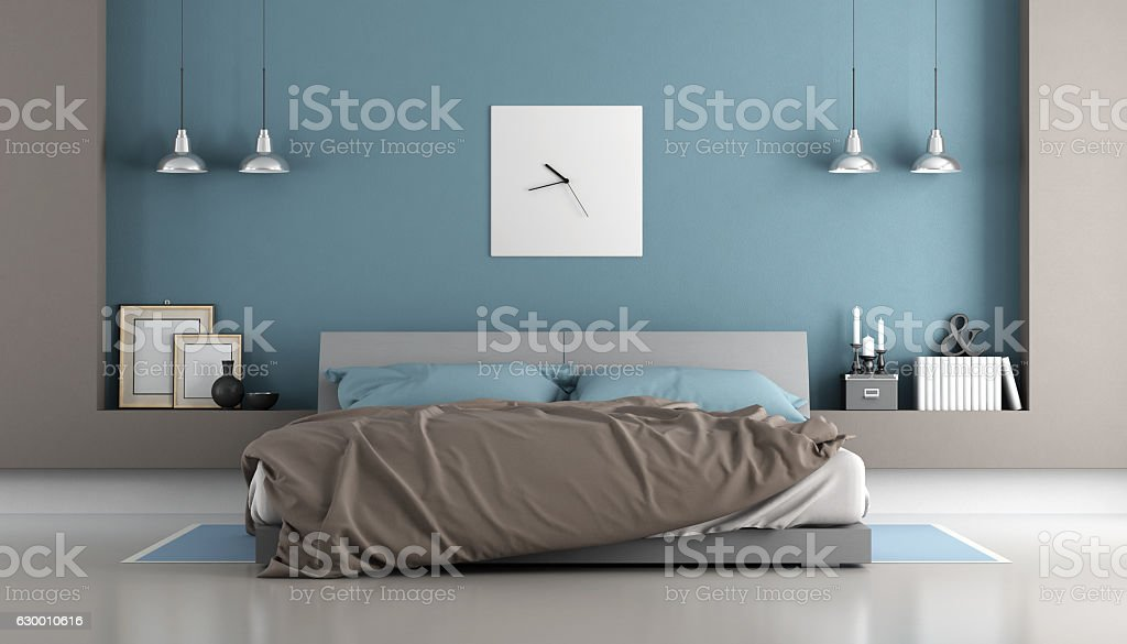 Blue and brown modern bedroom stock photo