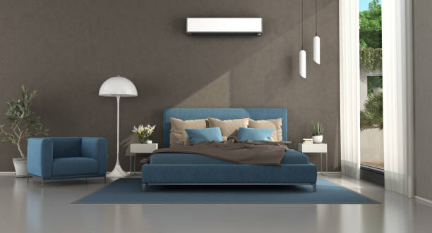 Blue and brown modern master bedroom stock photo