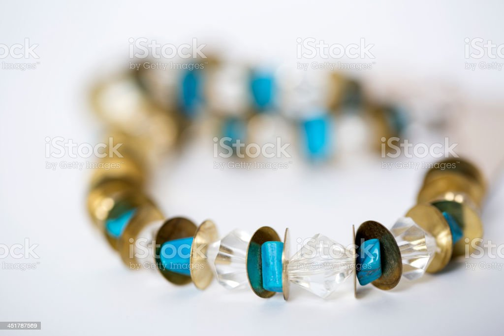 Blue and gold beaded Necklace royalty-free stock photo