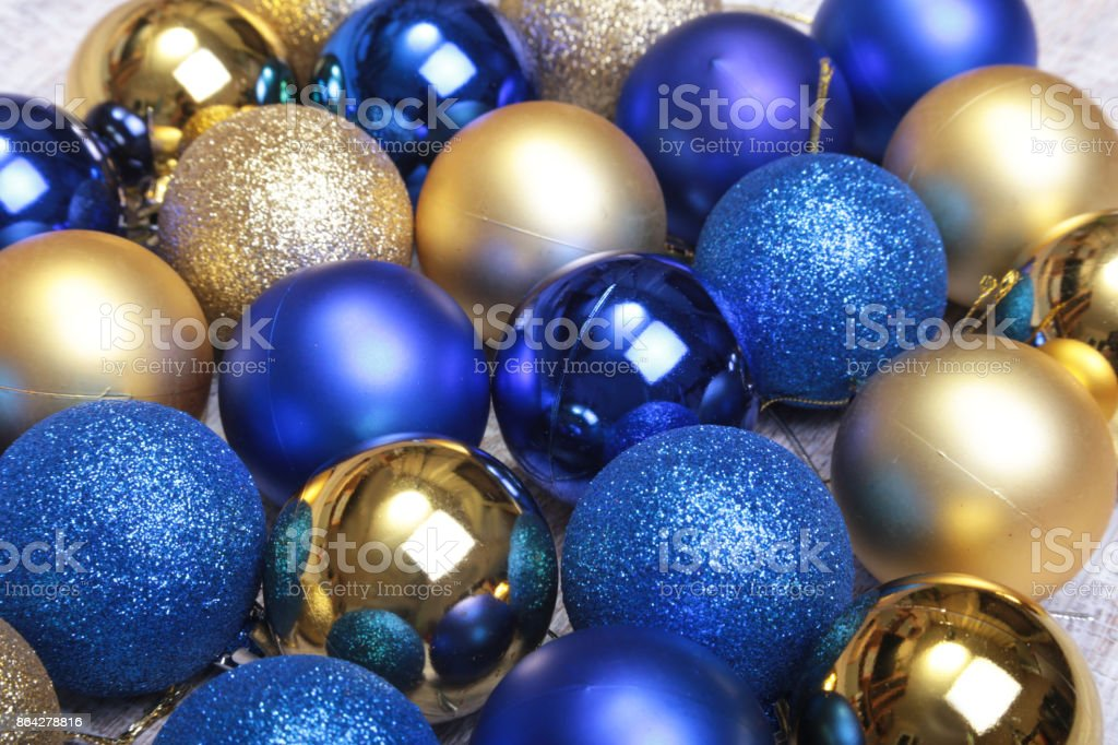 Blue and gold christmas balls on a wooden background royalty-free stock photo