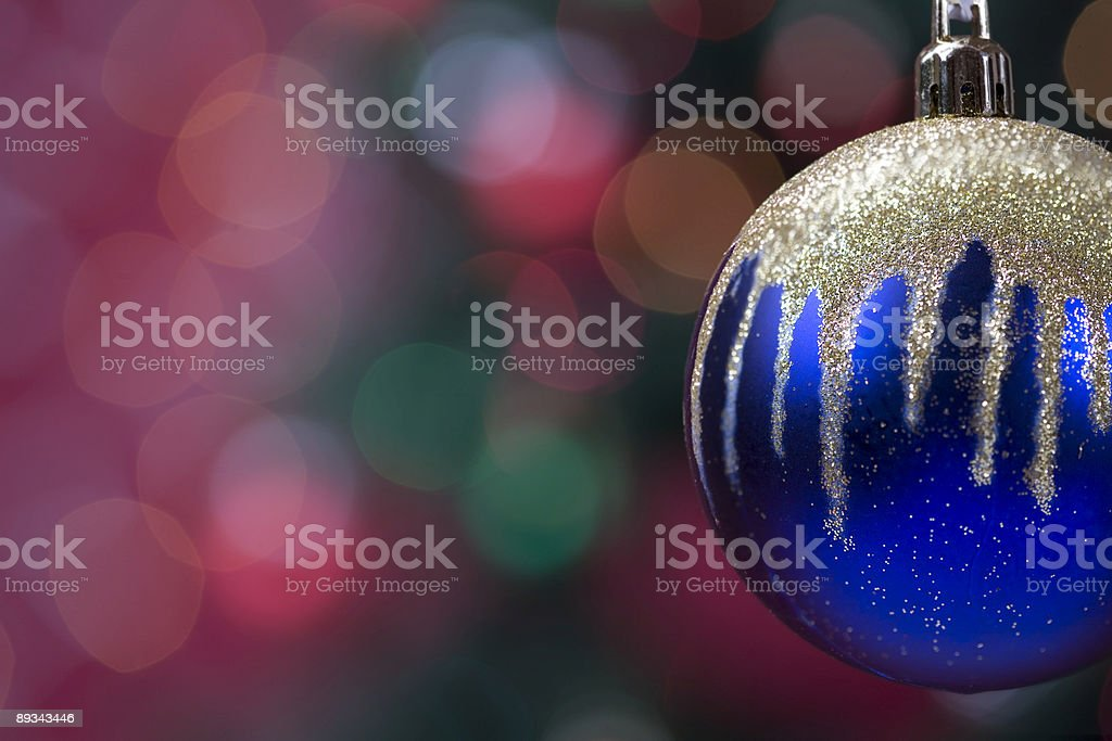 Blue and Gold Christmas Ornament with Tree Lights, Copy Space royalty-free stock photo