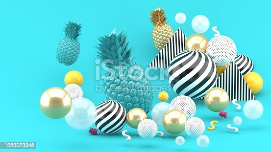 917861766 istock photo Blue and golden pineapple amidst golden balls on a blue background.-3d render. 1253073348