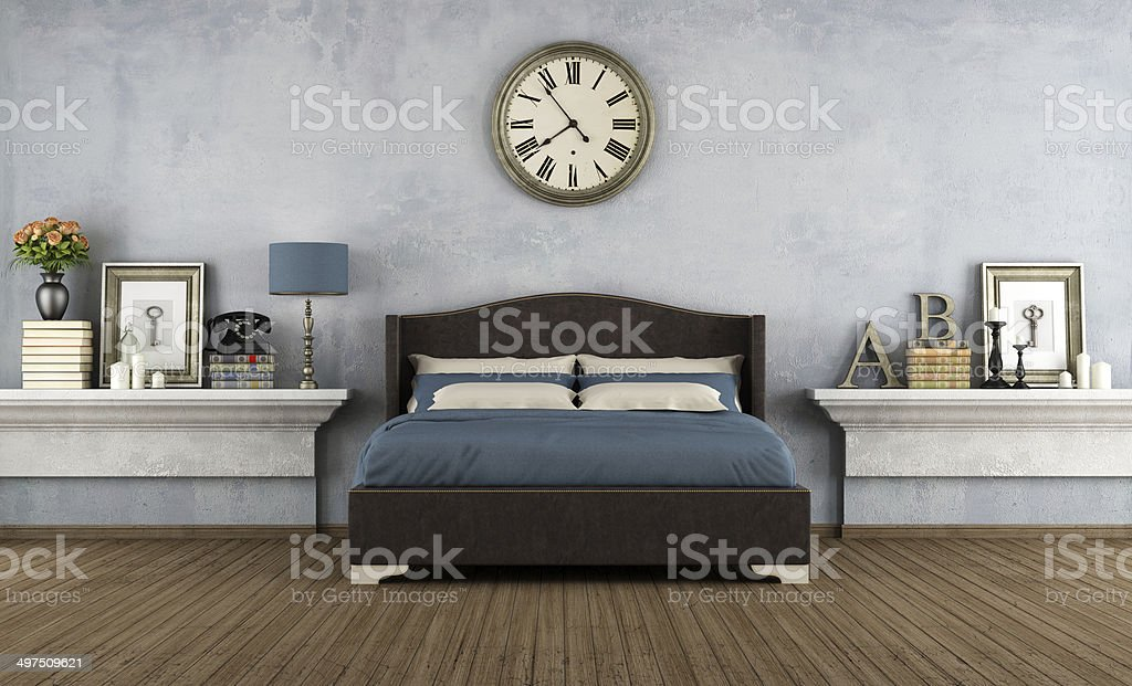 Blue and gray bedroom with vintage clock stock photo