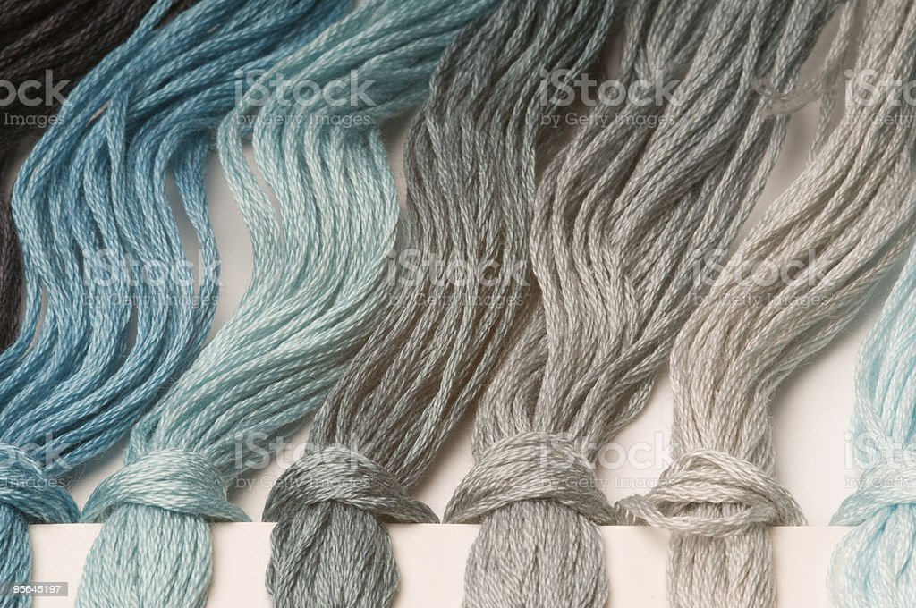 Blue and gray embroidery thread royalty-free stock photo
