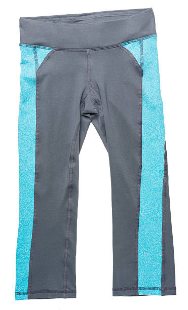 Blue and gray women's athletic pants on white stock photo