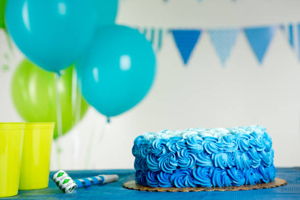 blue and green birthday decoration - happy birthday banner stock photos and pictures