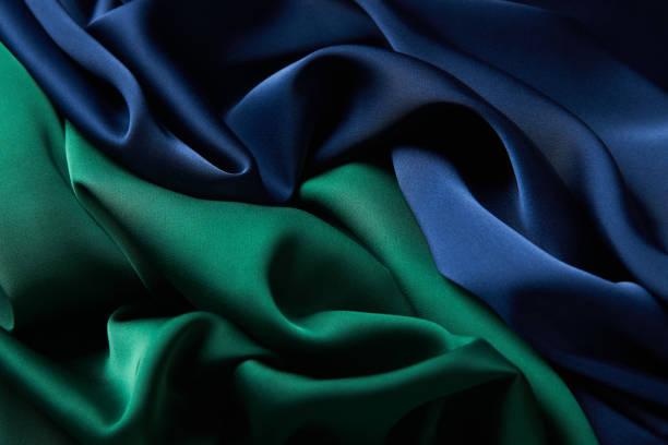 藍色和綠色絲綢面料背景,頂視圖。圖像檔
