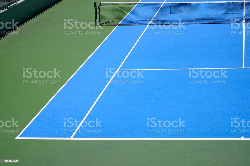 blue and green tennis court stock photo