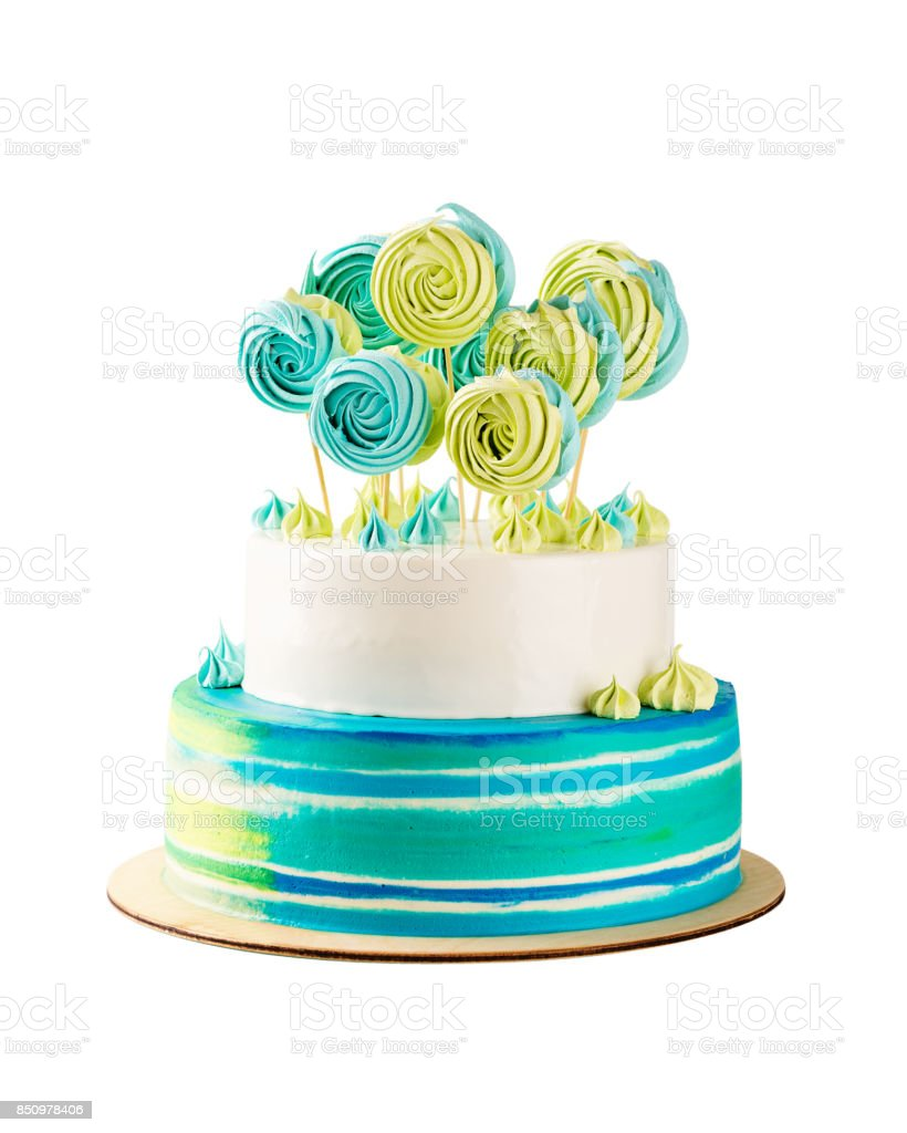 Blue and green tiered birthday cake isolated on white stock photo