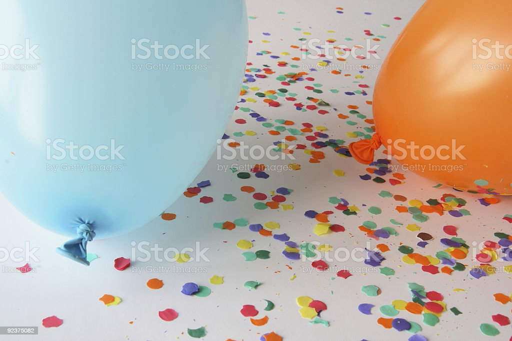 Blue and orange balloons with confetti royalty-free stock photo