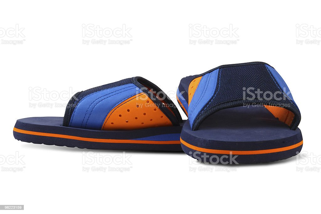 Blue and orange color slippers royalty-free stock photo