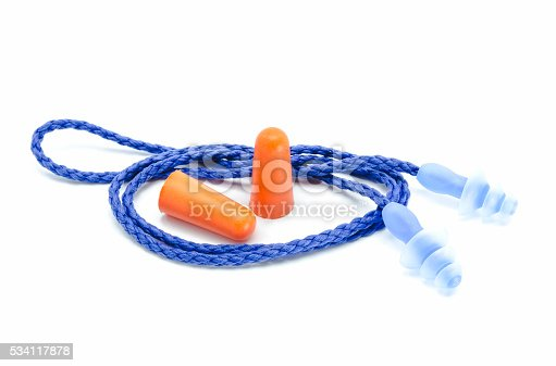 istock Blue and orange earplugs with a string on white background. 534117878
