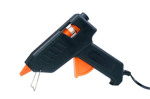 Blue and orange hot glue gun on white background stock photo