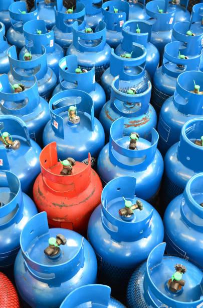 Blue and orange LPG tank stock photo
