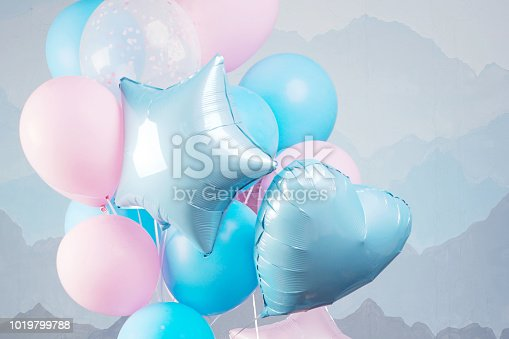 945748362istockphoto Blue and pink balloons in studio. Close up picture. 1019799788