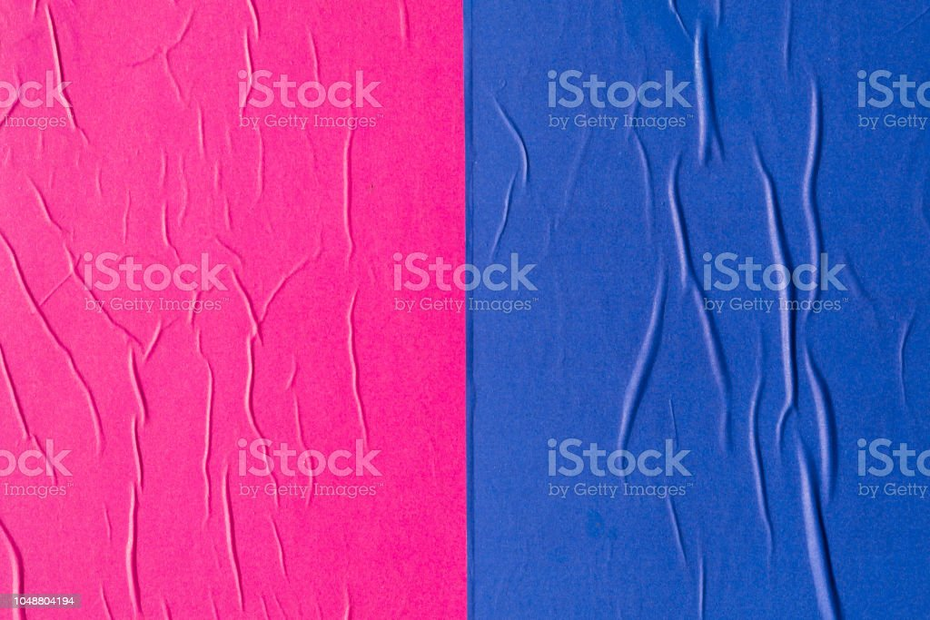 Blue and pink creased poster texture stock photo