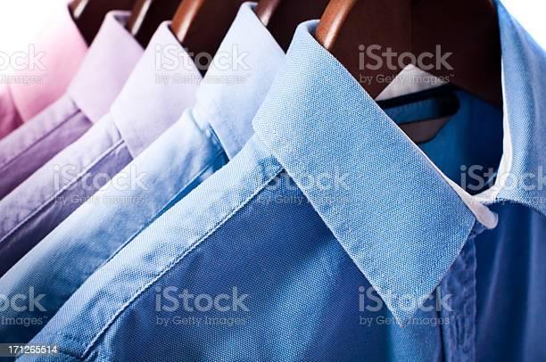 Blue and pink elegant button down shirts hanging on hangers picture id171265514?b=1&k=6&m=171265514&s=612x612&h=h6irardv0wbwfibvbtaaivt39vg1p98u0ovwtb908hc=