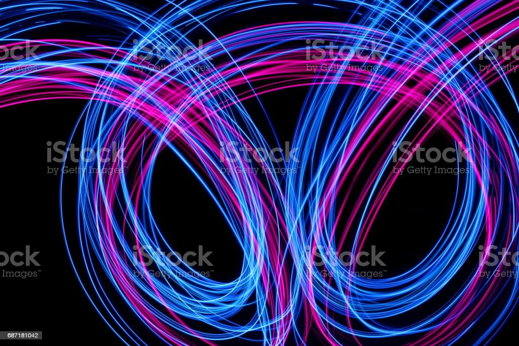 Blue And Pink Light Painting Photography Smooth Line Patterns Against A Black Background Royalty