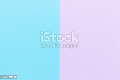 istock Blue and pink pastel color paper background 1071406496