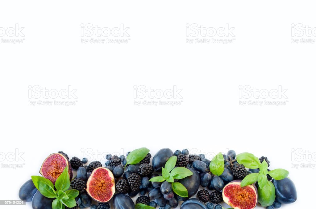 blue and purple food. Blueberries, blackberries, grapes, plums and figs royalty-free stock photo