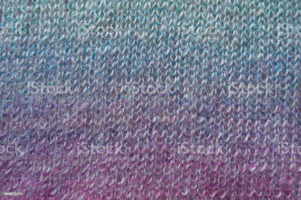 Blue and purple knitted fabric from above stock photo
