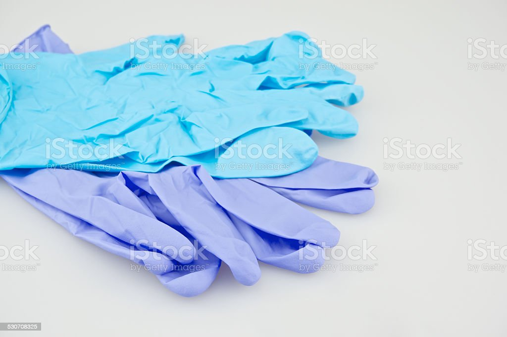 Blue and purple latex gloves stock photo