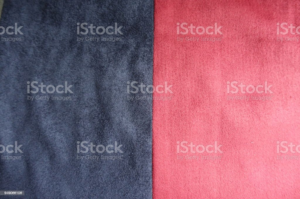 Blue and red artificial suede sewn together vertically stock photo