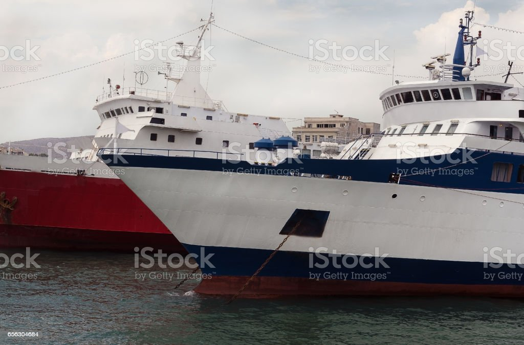 blue and red ship close-up