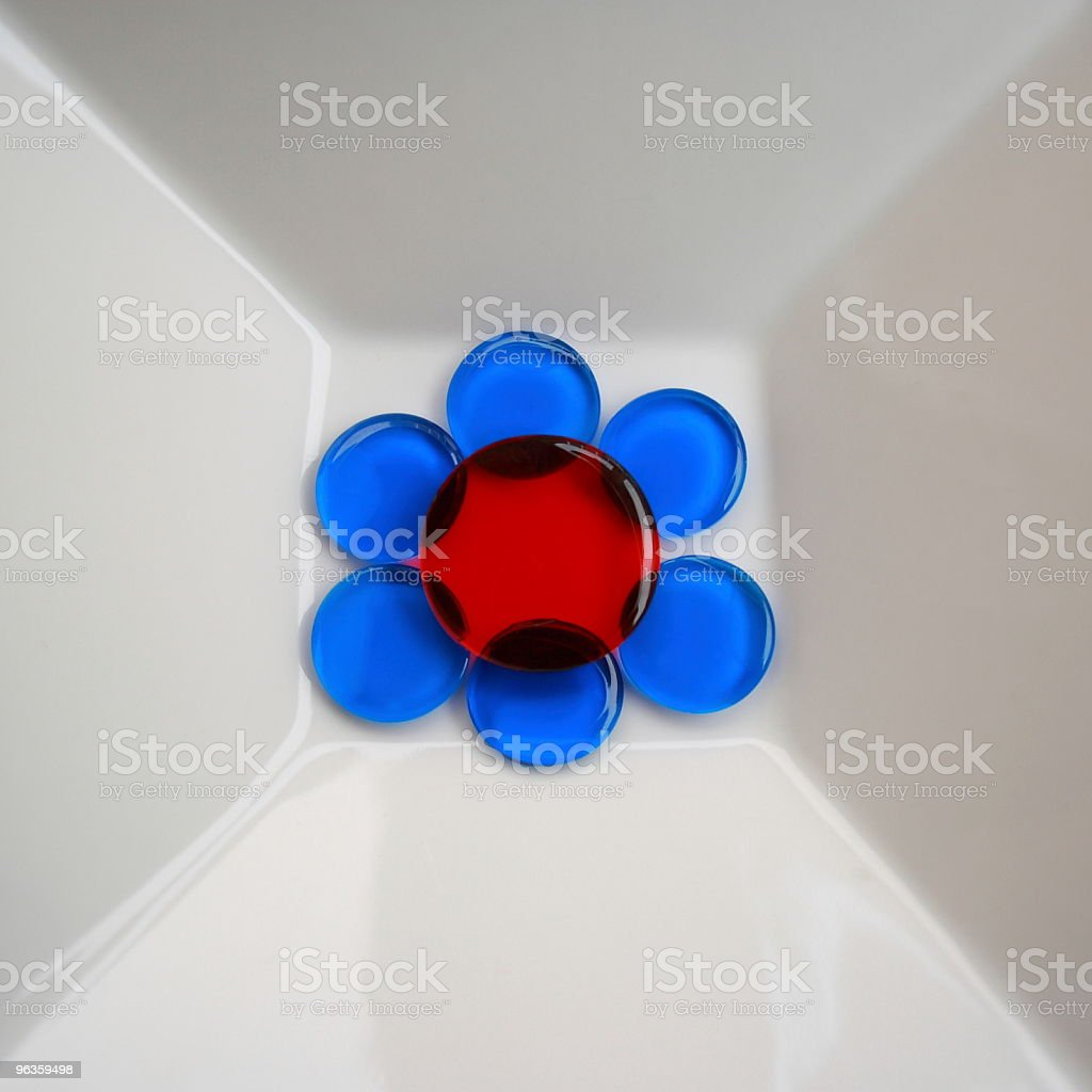 blue and red circles create flower in white dish royalty-free stock photo