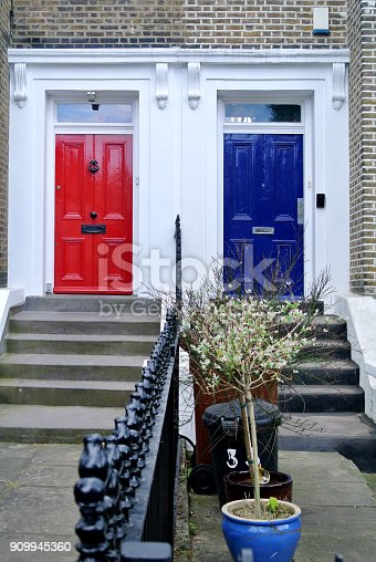 istock blue and red doors 909945360