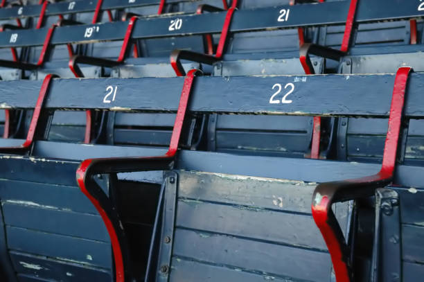 Blue and red empty stadium seats stock photo